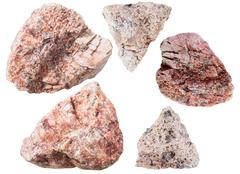 pink granitic gneiss rock and granite stones - stock photo