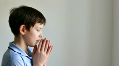 Stock Video Footage of boy teen praying belief in god