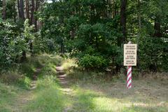 Military area keep out no entry sign in four languages: polish, english, germ - stock photo