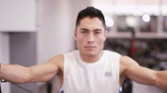 4K Muscular man working out on strength training machine at the gym - stock footage