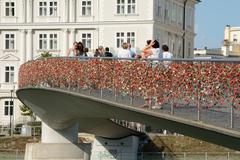 Salzburg, Austria - September 1, 2015: Pedestrian bridge with thousands of pa - stock photo