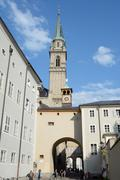 Salzburg, Austria - September 1, 2015: Cathedral tower and other buildings in - stock photo