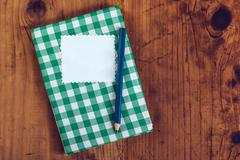 Handmade recipe cookbook on kitchen desk Stock Photos