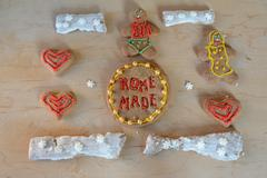 Different shape gingerbreads. Home made text on one of them. Stock Photos