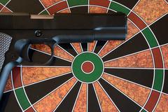 Airsoft gun on target - dartboard Stock Photos