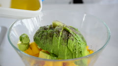 Cooking with avocado fruit and olive oil ingredients Stock Footage
