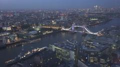 4K Aerial view London cityscape twilight tourist destination Tower Bridge iconic Stock Footage
