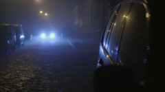 The car with a hazard warning light on a dark background. Evening-night time Stock Footage