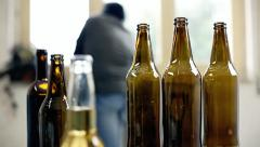 Drunk man bottles confused Stock Footage