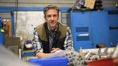 Metal worker standing in workshop looking at camera Stock Footage