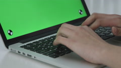 Girl Typing with Green Screen macbook pro Stock Footage