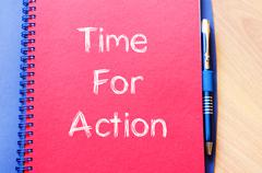 Time for action write on notebook - stock photo