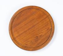 Round wooden cutting board with groove - stock photo