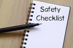 Safety checklist write on notebook Stock Photos