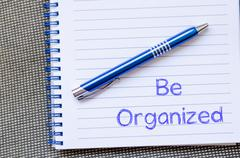 Stock Photo of Be organized write on notebook