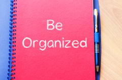 Be organized write on notebook - stock photo