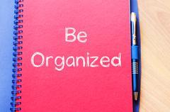 Be organized write on notebook Stock Photos