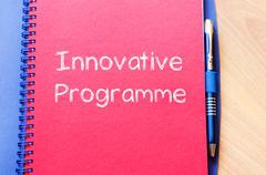 Innovative programme write on notebook - stock photo
