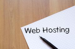 Web hosting write on notebook - stock photo