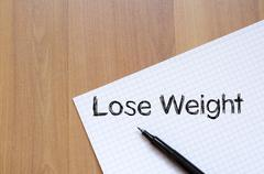 Lose weight write on notebook Stock Photos