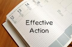 Effective action write on notebook - stock photo