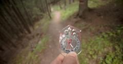 finding the right position in the forest with and compass - stock photo