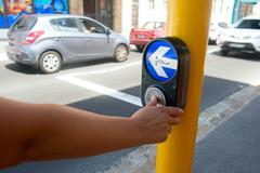 Stop button on the pedestrian crossing Stock Photos