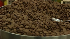 Bowl of brown milk chocolate chips Stock Footage