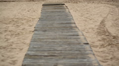 Wooden plank path beach ocean horizon, foggy mist, tilt up, Portugal Stock Footage