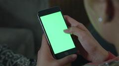 Girl Using green screen iphone Stock Footage
