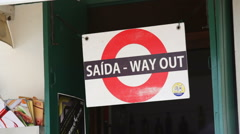 Stock Video Footage of Saida, way out sign in Portuguese, medium shot, Portugal