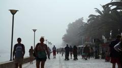 People walk on boardwalk, Lagos, Algarve, south Portugal - stock footage