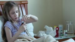 Sick child girl 7 years old takes pills without asking adults Stock Footage