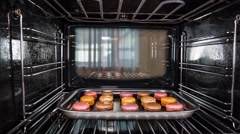 Baking macarons in the oven. Stock Footage