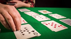Close up of female hands holding cards and playing solitaire Stock Footage