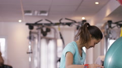 4K Female friends at the gym take a break from working out to chat Stock Footage