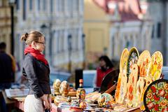 Stock Photo of young woman looking at the goods on Andrew's descent, Kiev, Ukraine