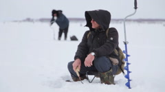Ice Fishing on the Lake. many fishermen Stock Footage