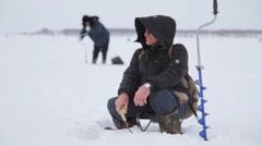Ice Fishing on the Lake. many fishermen Arkistovideo