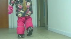 Little Girl With Long Braid is Walking Home Enters the Building in Winter Slow Stock Footage