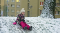 Happy Little Girl Runs Slides Downhill by Ice Raising up and Walking Smiling Stock Footage