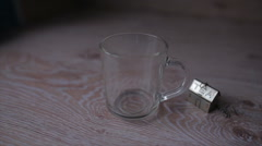 In a transparent cup and pour hot water to make tea Stock Footage