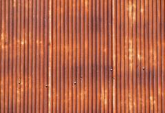 Old bright rust corroded metal goffered surface Stock Photos
