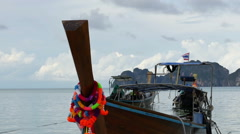Group of decorated traditional Thai boats moored at the sandy beach, Krabi, Stock Footage