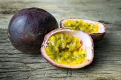 Passion fruit on wooden table - stock photo