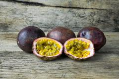 Passion fruit on wooden table Stock Photos