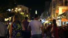 BITOLA, MACEDONIA - JULY, 2015: People walking on main street at night. Stock Footage