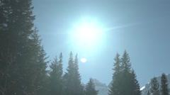 Snowy High Peaks Sun Flares Panning 4K Stock Footage
