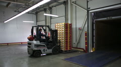 Forklift of transport company unload pallets with goods from truck Stock Footage