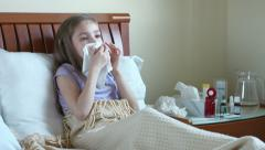 Sick girl 7 years old baby sneeze and cough into a handkerchief - stock footage